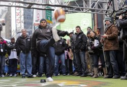 "Nick Lachey watches New York Giants Antonio Pierce kick a field goal at the ""Tostitos Fiesta in the Square"" in New York"