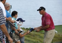 Lehman signs autographs during PGA Championship practice
