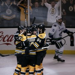 Bruins celebrate second period goal against Canucks in game 4 of the NHL Stanley Cup Finals in Boston, MA.