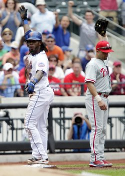 New York Mets Jose Reyes and Philadelphia Phillies Placido Polanco react at Citi Field in New York
