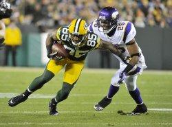 Vikings Winfield tackles Packers Jennings in Green Bay, Wisconsin