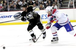Penguins Kennedy Clears Puck Away Canadiens Gionta in Pittsburgh