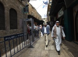 Palestinians Walk Past Metal Detectors In Muslim Quarter