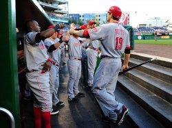 Reds' Joey Votto is congratulated by teammates in Washington