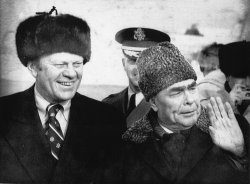 Gerald Ford is being greeted at airport in Vladivostok by Leonid Brezhnev..