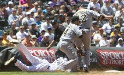 Pirates Barmes Gets in the Way of Teammate Alvarez's Tag on Rockies Fowler in Denver