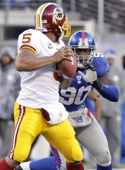 New York Giants Jason Pierre-Paul puts pressure on Washington Redskins quarterback Donovan McNabb at New Meadowlands Stadium in New Jersey