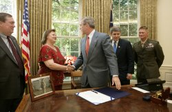 BUSH SIGNS LAW NAMING POST OFFICE IN HONOR OF MARINE