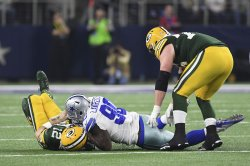 Dallas Cowboys Demarcus Lawrence sacks Packers quarterback Aaron Rodgers
