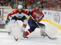 Capitals Fleischmann and Panthers Seidenberg go after puck in Washington