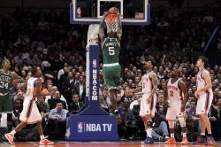 New York Knicks Toney Douglas, Wilson Chandler, Raymond Felton and Danilo Gallinari watch Boston Celtics Kevin Garnett dunk at Madison Square Garden in New York