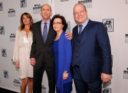 Melissa Aronson, Chris Aronson, Madeline Sherak and Dick Cook appear at the 2014 CinemaCon in Las Vegas