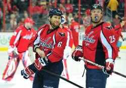 Capitals Dennis Wideman and Jason Chimera are seen on the ice in Washington