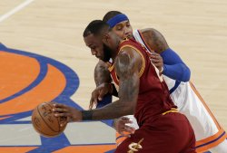 Cavaliers LeBron James steals the ball from Knicks Carmelo Anthony