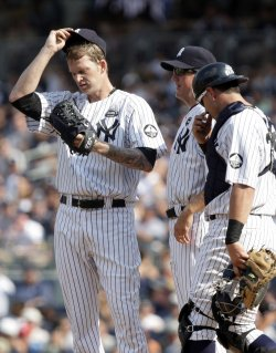New York Yankees starting pitcher A.J. Burnett throws reacts at Yankees Stadium in New York