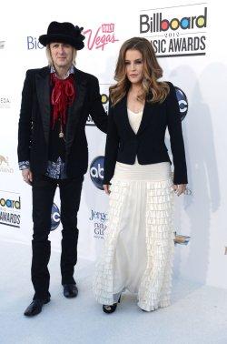Michael Lockwood (L) and Lisa Marie Presley (R) arrive at the 2012 Billboard Music Awards in Las Vegas, Nevada