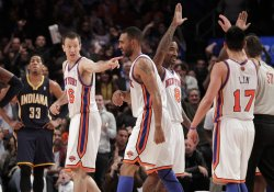 Indiana Pacers Danny Granger watches New York Knicks Steve Novak react with J.R. Smith and Jeremy Lin at Madison Square Garden in New York