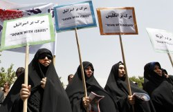 Iranians attend a demonstration to condemn killing of protesters in Bahrain