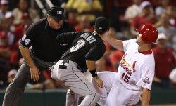 Cardinals Matt Holliday slides into third base