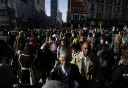 Shoppers walk in Herald Square on Black Friday