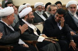 Iraian President Mahmoud Ahmadinejad is seen at a ceremony for Iran's new judiciary chief Sadeq Larijani in Tehran