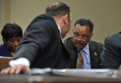 National Urban League President Marc Morial talks to Rev. Jesse Jackson in Washington
