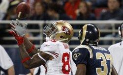 San Francisco 49ers Vernon Davis and St. Louis Rams James Butler