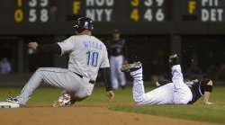 Blue Jays Wells Steals Second Base Against Rockies Barmes in Denver