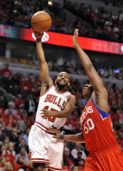 Bulls' Lucas shoots as 76ers' Allen defends during Playoff in Chicago