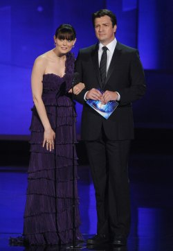 Actors Emily Deschanel and Nathan Fillion present an award at the 62nd annual Primetime Emmy Awards in Los Angeles