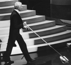 Master of Ceremonies Johnny Carson sweeps the stage at the 56th Annual Academy Awards