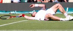 Andy Murray slips over on court on the second day of Wimbledon.