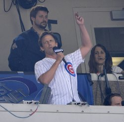 Meyers sings during seventh inning stretch in Chicago