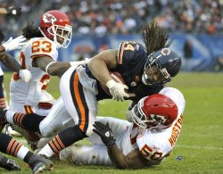 Chiefs Houston tackles Bears Barber in Chicago