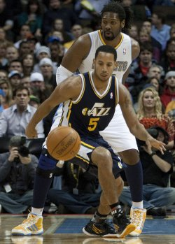Jazz Harris Goes for Loose Ball Against Nuggets Nene in Denver