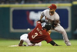 Houston Astros Second Baseman Kazuo Matsui Steals Second Base Past Arizona Diamondbacks Second Baseman Ryan Roberts at Minute Maid Park in Houston