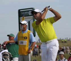 Stewart Cink talks tees off on the 11th hole during the Open Championship in England.