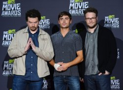 Actors Danny McBride, Zac Efron and Seth Rogen appear backstage at 2013 MTV Movie Awards in Culver City, California