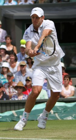 Andy Roddick plays a backhand on the third day of Wimbledon.