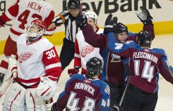 Avalanche''s Duchene Celebrates Goal Against the Red Wings Goalie Osgood in Denver