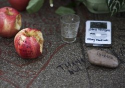 Well wishers mourn the death of Steve Jobs in Palo Alto