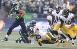 Seattle Seahawks Thomas Rawls runs fior 81 yards against the Pittsburgh Steelers in Seattle