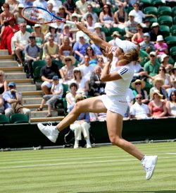 Justine Henin in mid air on the third day of Wimbledon.
