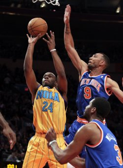 New York Knicks Jared Jeffries tries to block a shot by New Orleans Hornets Carl Landry at Madison Square Garden in New York