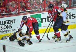 Washington Capitals Brooks Laich holds down Boston Bruins' Shawn Thornton in Washington