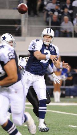 A Dallas Cowboys quarterback Jon Kitna throws against the New Orleans Saints