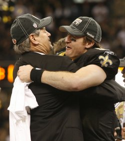 New Orleans Saints quarterback Drew Brees celebrates with his general manger Mickey Loomis after winning the NFC title