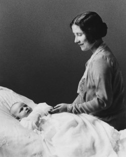 Queen Elizabeth lovingly gazes at her newborn, Princess Margaret in 1930