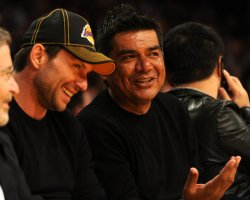 Christian Slater and George Lopez sitting courtside for Lakers' game against the Celtic's in Los Angeles