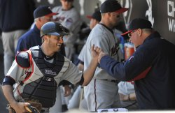 Twins manager Gardenhire and catcher Butera slap hands in dugout in Chicago
